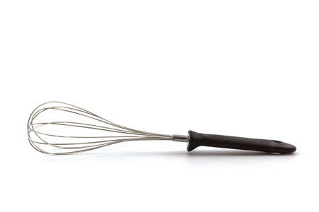 house ware: Metal whisk for whipping eggs on white background, House ware.  Stock Photo
