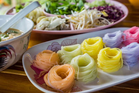 Colorful of Thai vermicelli, rice noodles eaten with curry,Thai food. photo