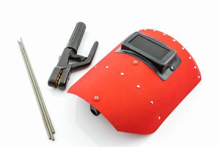 Red protective screen and rod-holder with Welding electrodes wire, for electric arc welding, on white background. photo