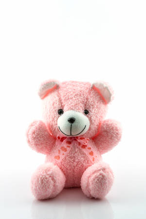 Pink teddy bear on white background.