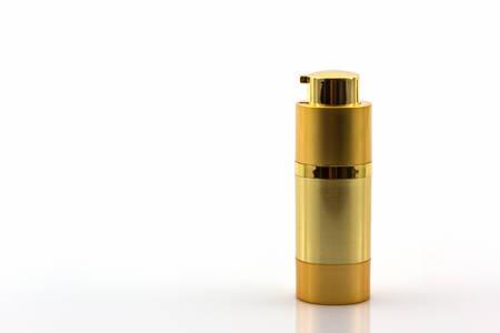 Cosmetics bottle, Golden Blank packaging bottle on white background. photo