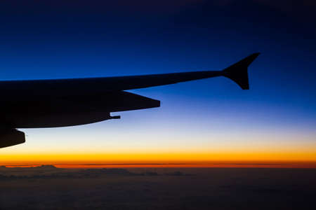 Airplane in the sky with skylines and twilight at the sunrise photo