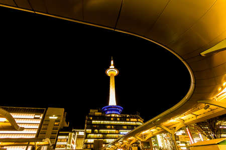 city light: Kyoto Tower in Kyoto with dark sky.