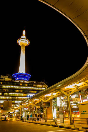 Kyoto, Japan - October 23, 2014: Kyoto tower with dark sky in Japan. The steel tower is the tallest structure in Kyoto with its spire at 131 metres (430 ft).