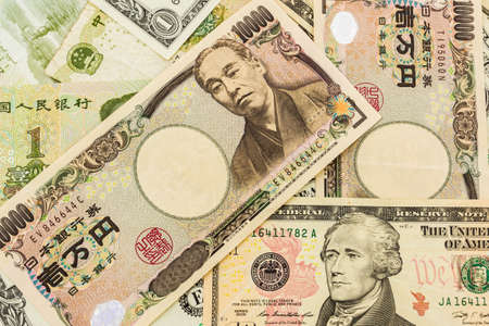 Colorful of  World banknotes background,dollar,Japanese Yen,Chinese yuan banknotes. Stock Photo