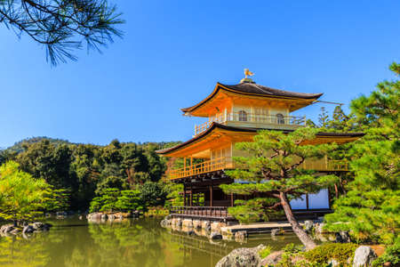 Kinkakuji temple, gold temple with reflection of water - Kyoto, Japan. photo