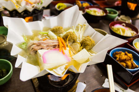 Nabemono or simply called nabe, refers to a variety of Japanese hot pot dishes, also known as one pot dishes. photo