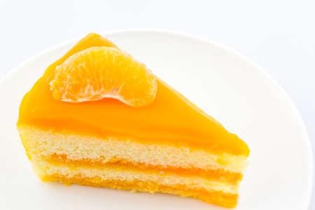 custard slices: Oranges cake slice,fruit cake on white background.