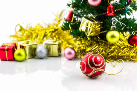 Christmas tree with colorful ornaments on white background. photo