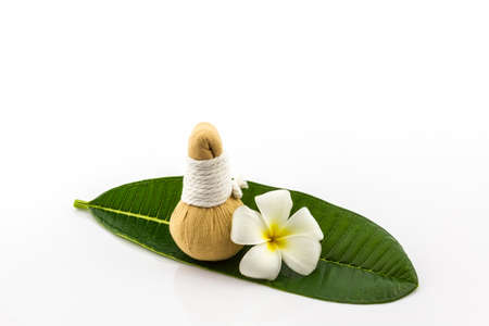 Spa herbal compressing ball and plumeria on white background.