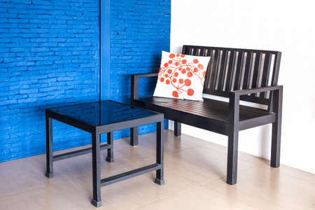 Modern interior table and chairs at the corner of blue wall. photo