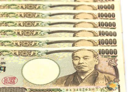 yen note: Japanese Yen banknotes on white background.
