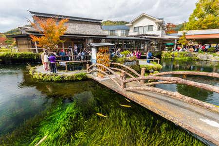 Oshino, Japan - October 26, 2014:Tourists visit Oshino Hakkai, a small village in the Fuji Five Lake region, located between Lake Kawaguchiko and Lake Yamanakako.