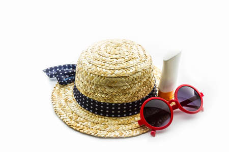 sun hat: Woven hat, red sunglasses with body lotion on white background. Stock Photo