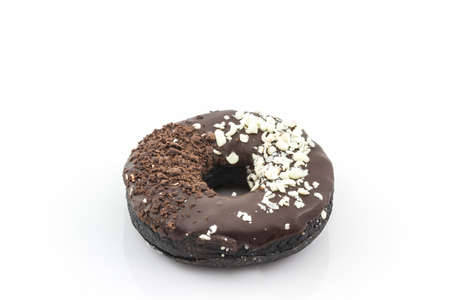 sprinkles: Chocolate donut with Sprinkles on white background.