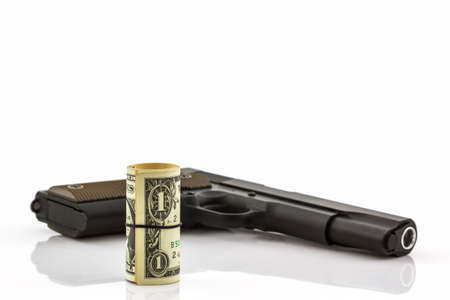 organized crime: Close up money with Gun on white background. Stock Photo