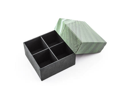 compartments: Green paper box with divided compartments on white background. Stock Photo