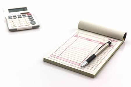 Invoice book which open blank page with pen and calculator on white background.