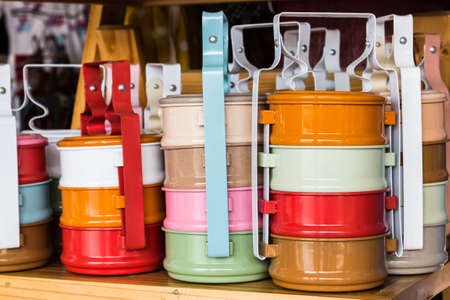 tiffin: Colorful of tiffin box on shelf for sale.. Stock Photo