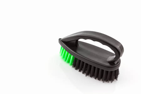 messy clothes: Black cleaning plastic brush on white background. Stock Photo
