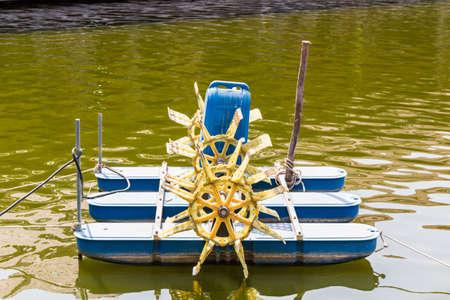water turbine: Water turbine fill oxygen into water in lake.