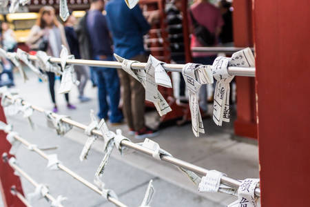 charms: Omikuju Charms or fortune paper, Prayer notes at asakusa temple in Japan.