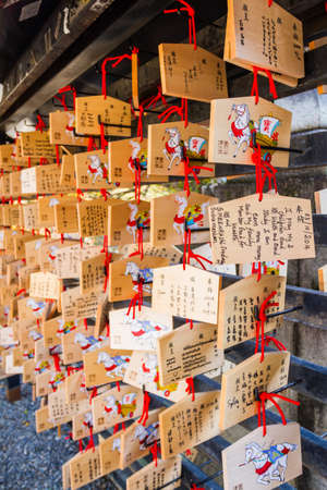 ema: Kiyomizu-dera Temple Kyoto,, Japan - October 24, 2014: A Japanese votive plaque(Ema) hanging in Kiyomizu temple,Ema are small wooden plaques used for wishes by shinto believers.
