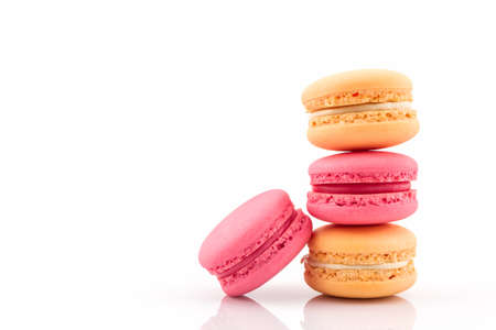 Sweet and colourful french macaroons or macaron on white background, Dessert. photo
