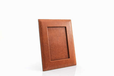 tableau: Vintage leather picture frame on white background.