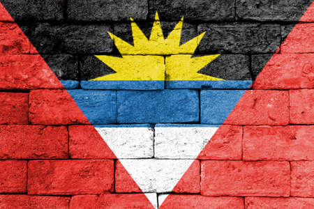 brick and mortar: Flag of Antigua and Barbuda painted over on old brick wall. Stock Photo