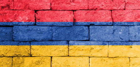 brick and mortar: Flag of Armenia painted over on old brick wall.