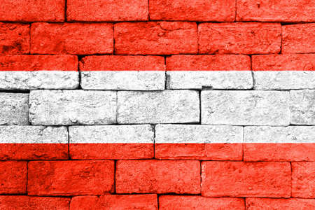 brick and mortar: Flag of Austria painted over on old brick wall.