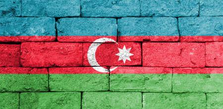 brick and mortar: Flag of Azerbaijan painted over on old brick wall.
