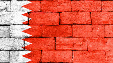 brick and mortar: Flag of Bahrain painted over on old brick wall. Stock Photo