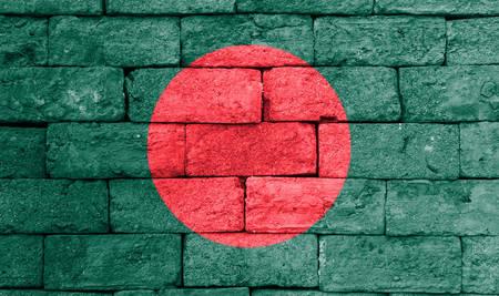 brick and mortar: Flag of Bangladesh painted over on old brick wall.