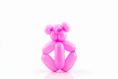 Balloon animal of pink bear action pose on white background. Reklamní fotografie