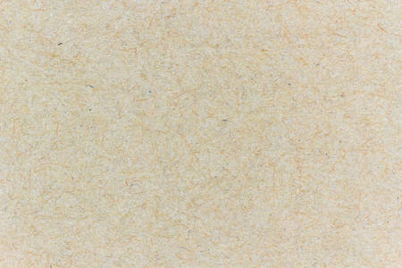 Closeup detail brown cardboard texture a background.