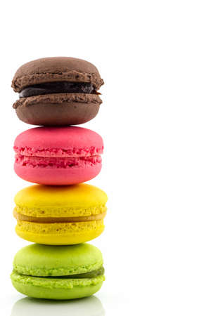 Sweet and colourful french macaroons or macaron on white background, Dessert.