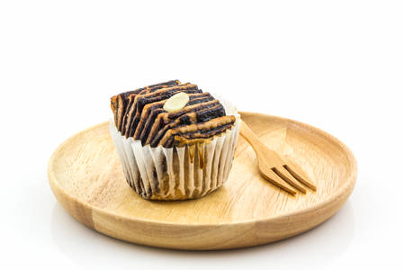 flaky: Chocolate flaky mini bread in the wooden plate on white background.