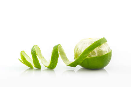 lime juice: Fresh limes on white background. Stock Photo
