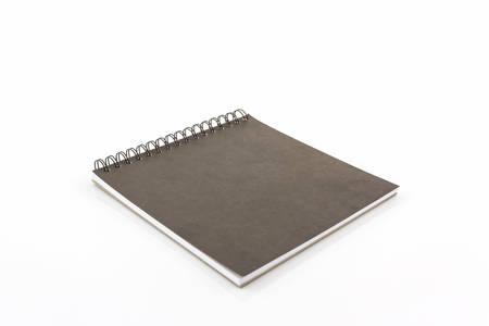 sketch book: Close up black sketch book on white background.