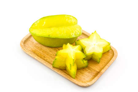 star fruit: Star fruit or Carambola in wooden plates on white background.