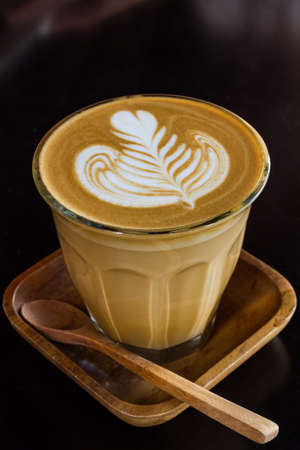 Cup of cappuccino or latte coffee.