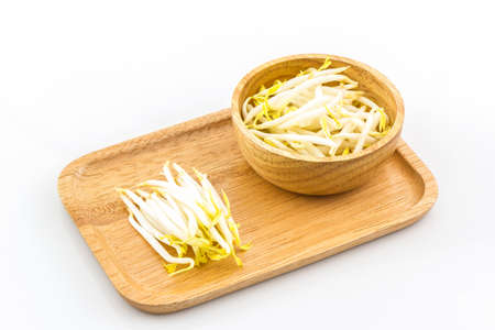 soja: Bean sprout in the in wooden plate on white background.