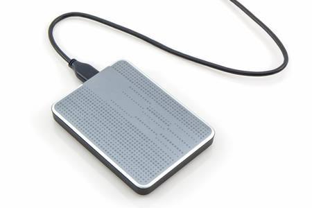 gigabytes: External hard drive for backup on white background.