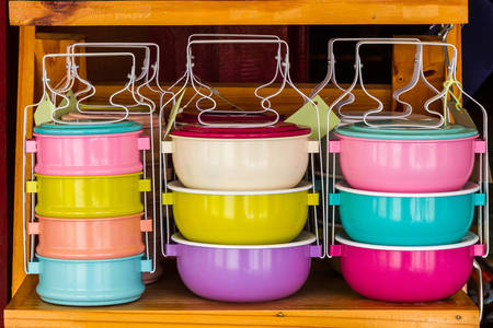 tiffin: Colorful of tiffin box on shelf for sale.