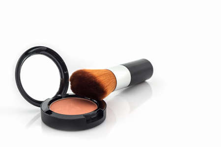 closeup: Closeup of face powder and makeup brush on white background.