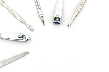 manicure set: Tools of a manicure set on white background.