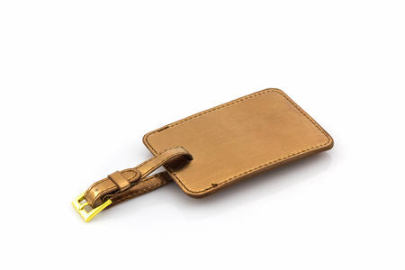 luggage tag: Golden leather luggage tag on white background.