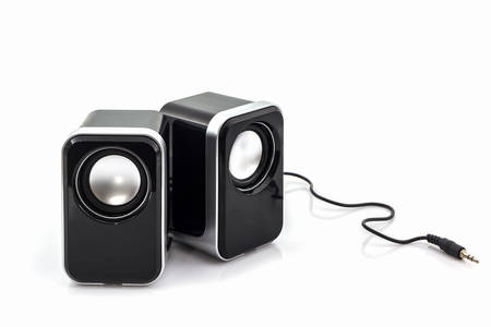 speakers: Small computer speakers on white background. Stock Photo